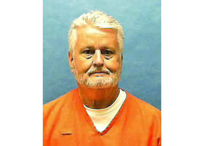 This updated photo made available by the Florida Department of Law Enforcement shows Bobby Joe Long in custody. Long, is scheduled to be executed Thursday, May 23, 2019, for killing 10 women during eight months in 1984 that terrorized the Tampa Bay area. He was sentenced to 401 years in prison, 28 life sentences and one death sentence. His execution is for the murder of 22-year-old Michelle Simms. (Florida Department of Law Enforcement via AP)