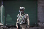 "A paramilitary soldier stands guard during curfew in Srinagar, Indian controlled Kashmir, Tuesday, Aug. 4, 2020. Authorities clamped a curfew in many parts of Indian-controlled Kashmir on Tuesday, a day ahead of the first anniversary of India's controversial decision to revoke the disputed region's semi-autonomy. Shahid Iqbal Choudhary, a civil administrator, said the security lockdown was clamped in the region's main city of Srinagar in view of information about protests planned by anti-India groups to mark Aug. 5 as ""black day."