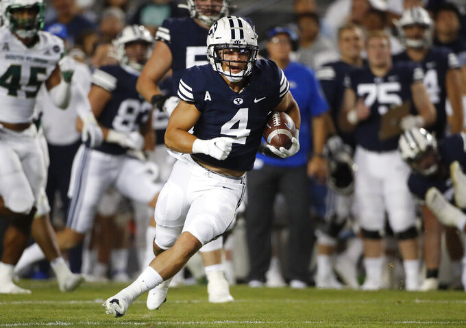 BYU running back Lopini Katoa (4) carries the ball in the first half of an NCAA college football game against South Florida Saturday, Sept. 25, 2021, in Provo, Utah. (AP Photo/George Frey)