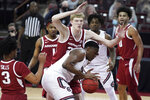 Arkansas forward Connor Vanover, center, defends against South Carolina center Tre-Vaughn Minott, front, during the first half of an NCAA college basketball game Tuesday, March 2, 2021, in Columbia, S.C. (AP Photo/Sean Rayford)