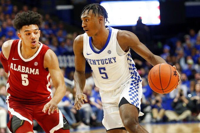 Kentucky's Immanuel Quickley, right, drives on Alabama's Jaden Shackelford during the second half of an NCAA college basketball game in Lexington, Ky., Saturday, Jan 11, 2020. Kentucky on 76-67. (AP Photo/James Crisp)