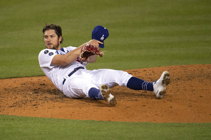 Los Angeles Dodgers starting pitcher Trevor Bauer reacts after avoiding a line drive by San Diego Padres' Eric Hosmer during the sixth inning of a baseball game in Los Angeles, Saturday, April 24, 2021. (AP Photo/Kyusung Gong)