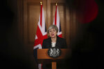 Britain's Prime Minister Theresa May delivers a statement, at 10 Downing Street, in London, Wednesday, March 20, 2019. May says it's a matter of