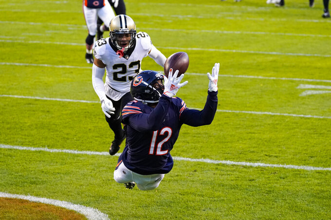 Chicago Bears wide receiver Allen Robinson (12) makes a catch for a touchdown in front of New Orleans Saints cornerback Marshon Lattimore (23) in the first half of an NFL football game in Chicago, Sunday, Nov. 1, 2020. (AP Photo/Nam Y. Huh)