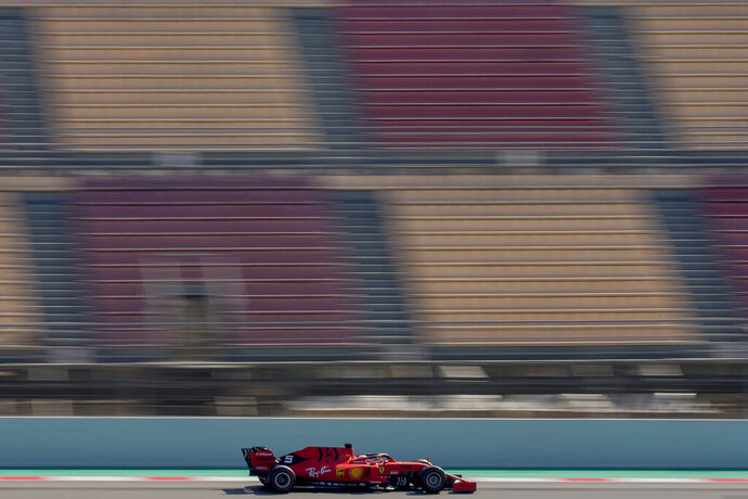 FILE - In this file photo dated Friday, March 1, 2019, Ferrari driver Sebastian Vettel of Germany during a Formula One pre-season testing session at the Barcelona Catalunya racetrack in Montmelo, outside Barcelona, Spain.  Previewing the upcoming 2019 season, after two seasons cracking under pressure, this may be Sebastian Vettel's last chance to show he can deliver a long-awaited Formula One title for Ferrari. (AP Photo/Joan Monfort, FILE)