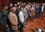 Presidential hopeful Pete Buttigieg, third from left, front row of the group, Mayor of South Bend, Ind., pauses for a group photo with students after speaking at Morehouse College on Monday, Nov. 18, 2019, in Atlanta. (Curtis Compton/Atlanta Journal-Constitution via AP)