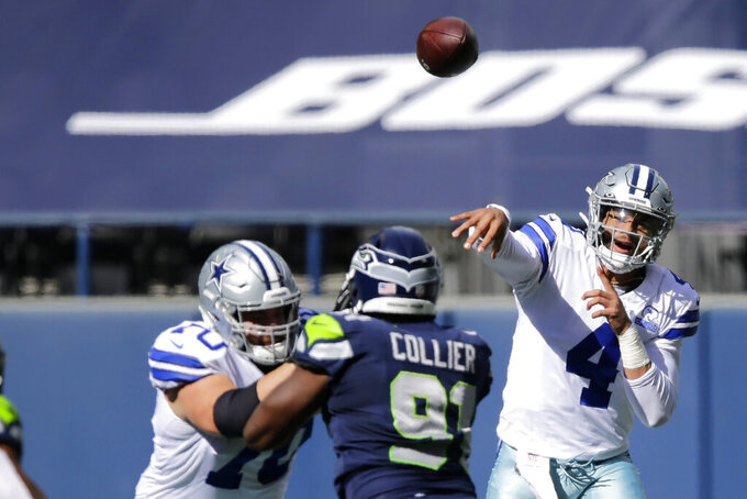 Dallas Cowboys quarterback Dak Prescott (4) passes against the Seattle Seahawks during the first half of an NFL football game, Sunday, Sept. 27, 2020, in Seattle. (AP Photo/John Froschauer)