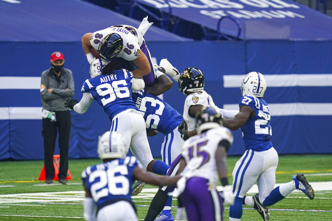 Baltimore Ravens tight end Nick Boyle (86) is tackled by Indianapolis Colts defensive tackle Denico Autry (96) and outside linebacker Darius Leonard (53) in the first half of an NFL football game in Indianapolis, Sunday, Nov. 8, 2020. (AP Photo/Darron Cummings)