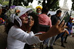 Women wearing Catrina makeup take a selfie before the parade down Mexico City's iconic Reforma avenue during celebrations for the Day of the Dead, Saturday, Oct. 26, 2019. (AP Photo/Ginnette Riquelme)