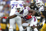 Buffalo Bills running back Devin Singletary (26) is tackled by Pittsburgh Steelers defensive end Tyson Alualu (94) during the first half of an NFL football game in Orchard Park, N.Y., Sunday, Sept. 12, 2021. (AP Photo/Joshua Bessex)