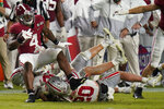 Alabama running back Brian Robinson Jr. is tackled by Ohio State during the second half of an NCAA College Football Playoff national championship game, Monday, Jan. 11, 2021, in Miami Gardens, Fla. (AP Photo/Chris O'Meara)