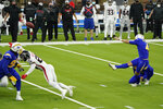 Los Angeles Chargers kicker Mike Badgley, right, kicks the game-winning field goal during the second half of an NFL football game against the Atlanta Falcons Sunday, Dec. 13, 2020, in Inglewood, Calif. (AP Photo/Ashley Landis )
