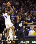 Seton Hall guard Myles Powell (13) shoots a 3-pointer as Villanova forward Saddiq Bey (15) defends during the first half an NCAA college basketball game, Saturday, March 9, 2019, in Newark, N.J. (AP Photo/Kathy Willens)