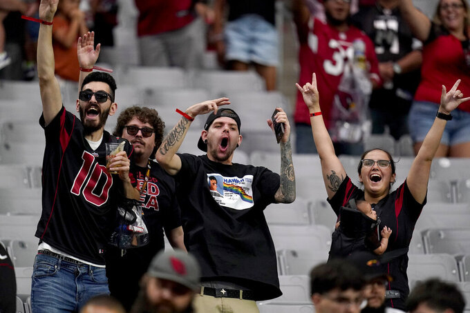 Arizona Cardinals fans cheer during the second half of an NFL football game against the Minnesota Vikings, Sunday, Sept. 19, 2021, in Glendale, Ariz. The Cardinals won 34-33. (AP Photo/Ross D. Franklin)