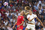 United States' Lindsey Horan, left, and England's Jill Scott challenge for the ball during the Women's World Cup semifinal soccer match between England and the United States, at the Stade de Lyon outside Lyon, France, Tuesday, July 2, 2019. (AP Photo/Laurent Cipriani)