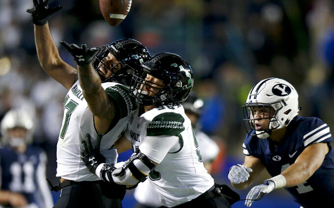 Hawaii linebacker Solomon Matautia (27) juggles the ball as he nearly intercepts a BYU pass during an NCAA college football game Saturday, Oct. 13, in Provo, Utah. (Isaac Hale/Daily Herald via AP)