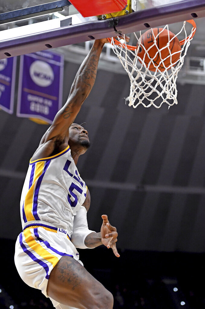 LSU forward Emmitt Williams (5) dunks during the first half of the team's NCAA college basketball game against UMBC, Tuesday, Nov. 19, 2019, in Baton Rouge, La. (AP Photo/Bill Feig)