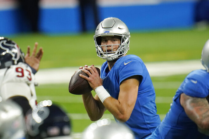 Detroit Lions quarterback Matthew Stafford looks downfield during the second half of an NFL football game, against the Houston Texans Thursday, Nov. 26, 2020, in Detroit. (AP Photo/Paul Sancya)