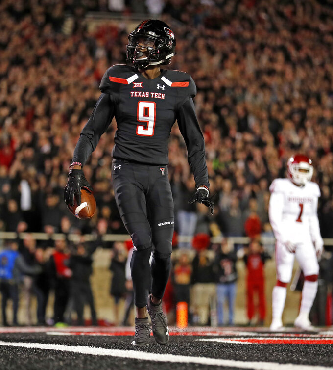 Texas Tech's T.J. Vasher (9) celebrates after scoring a touchdown during the first half of an NCAA college football game against Oklahoma, Saturday, Nov. 3, 2018, in Lubbock, Texas. (AP Photo/Brad Tollefson)