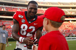Georgia tight end Kolby Wyatt (82) gives a youth his game gloves after an NCAA college football game against Murray State, Saturday, Sept. 7, 2019, in Athens, Ga. (Joshua L. Jones/Athens Banner-Herald via AP)