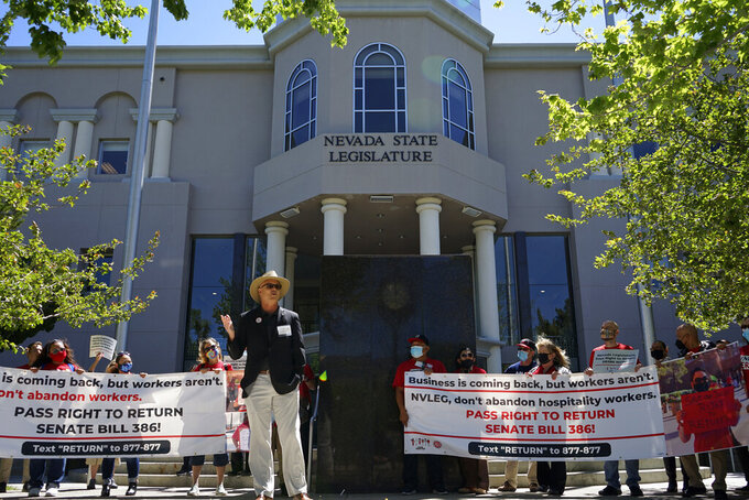 """Phil Jaynes, the president of the International Alliance of Theatrical Stage Employees Local 720, addresses demonstrators in front of the Nevada statehouse on Tuesday, May 18, 2021 in Carson City, Nev. Labor groups want state lawmakers to pass a bill guaranteeing workers laid off during the pandemic have a """"right to return"""" and get first priority when resorts and casinos need to rehire workers. (AP Photo/Samuel Metz)"""