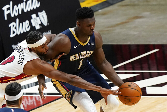 Miami Heat forward Moe Harkless attempts to steal the ball from New Orleans Pelicans forward Zion Williamson (1) during the first half of a preseason NBA basketball game, Monday, Dec. 14, 2020, in Miami. (AP Photo/Wilfredo Lee)