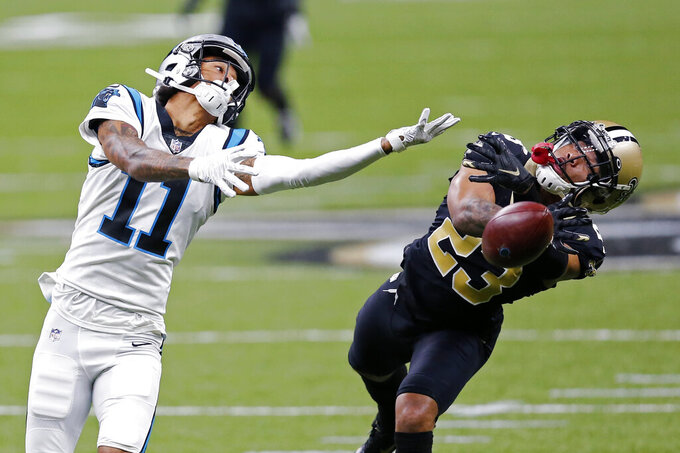 New Orleans Saints cornerback Marshon Lattimore (23) breaks up a pass intended for Carolina Panthers wide receiver Robby Anderson (11) in the second half of an NFL football game in New Orleans, Sunday, Oct. 25, 2020. (AP Photo/Brett Duke)