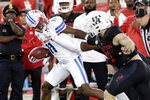 SMU wide receiver Rashee Rice (11) has his face mask grabbed on the tackle attempt by Houston safety Deontay Anderson behind defensive lineman Derek Parish, front right, during the first half of an NCAA college football game Thursday, Oct. 24, 2019, in Houston. (AP Photo/Michael Wyke)