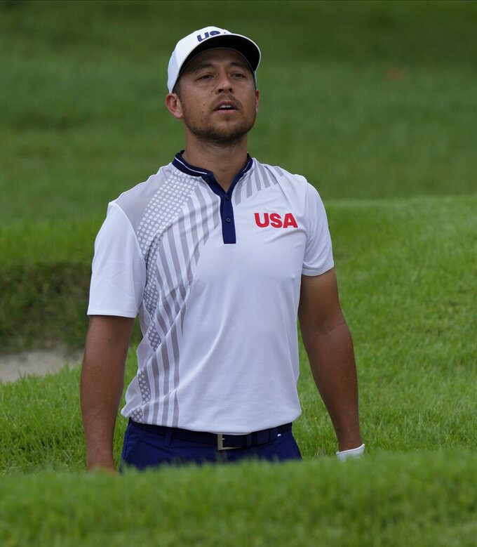 Xander Shauffele of United States studies his bunker shot on the first hole during the third round of the men's golf event at the 2020 Summer Olympics on Saturday, July 31, 2021, in Kawagoe, Japan. (AP Photo/Andy Wong)