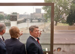 FILE - In this Friday, June 12, 1987 file photo, from right: U.S. President Ronald Reagan, Berlin Mayor Eberhard Diepgen and West German Chancellor Helmut Kohl look over the Berlin Wall. The U.S. Embassy in Berlin is unveiling the statue of Ronald Reagan as a tribute to the 30th anniversary of the fall of the Berlin Wall. The larger-than-life statue is being installed Friday atop the embassy's terrace, at eye-level with the landmark Brandenburg Gate in downtown Berlin. (AP Photo/Barry Thumma)