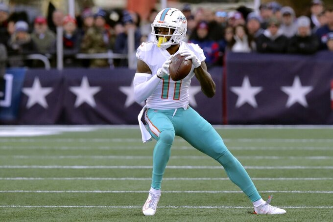 Miami Dolphins wide receiver DeVante Parker catches a pass against the New England Patriots in the first half of an NFL football game, Sunday, Dec. 29, 2019, in Foxborough, Mass. (AP Photo/Charles Krupa)