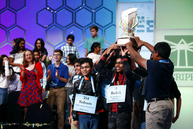 "FILE - In this May 31, 2019 file photos, eight co-champions celebrate after winning the Scripps National Spelling Bee, in Oxon Hill, Md. The Scripps National Spelling Bee has been canceled after organizers concluded there was ""no clear path to safely set a new date in 2020"" because of the coronavirus pandemic.  (AP Photo/Patrick Semansky)"