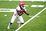 Rutgers wide receiver Aron Cruickshank runs with the ball against Maryland during the first half of an NCAA college football game, Saturday, Dec. 12, 2020, in College Park, Md. (AP Photo/Julio Cortez)