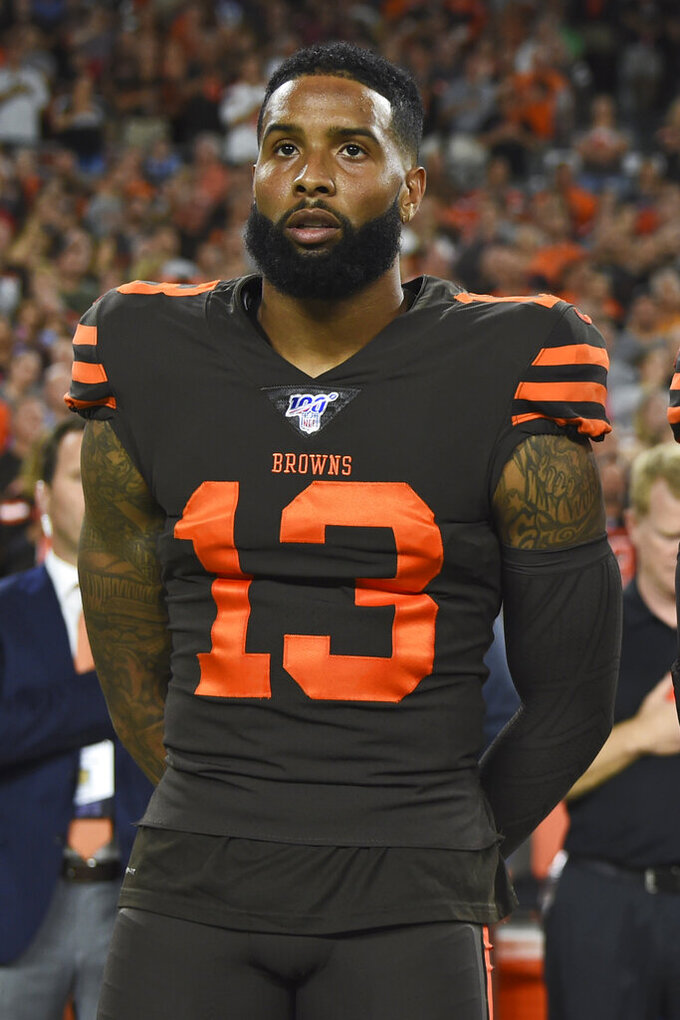 Cleveland Browns wide receiver Odell Beckham Jr. stands for the national anthem before an NFL football game against the Los Angeles Rams, Sunday, Sept. 22, 2019, in Cleveland. (AP Photo/David Dermer)