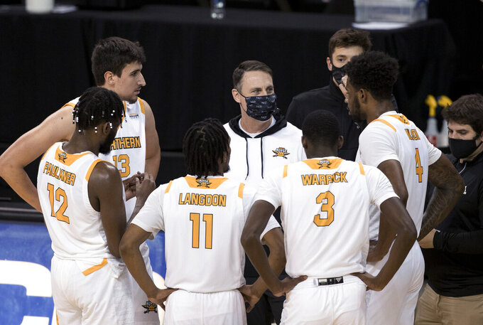 Northern Kentucky coach Darrin Horn speaks to the team during the second half of the team's NCAA college basketball game against Purdue-Fort Wayne on Friday, Jan. 1, 2021, in Highland Heights, Ky. (Albert Cesare/The Cincinnati Enquirer via AP)