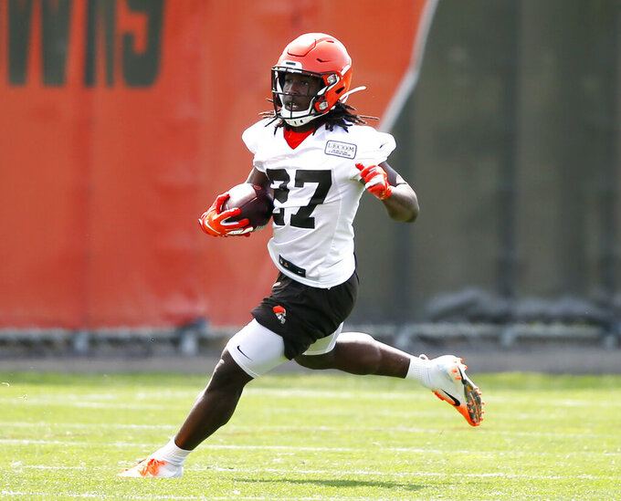Cleveland Browns' Kareem Hunt runs through a drill during an NFL football organized team activity session at the team's training facility Wednesday, May 15, 2019, in Berea, Ohio. (AP Photo/Ron Schwane)