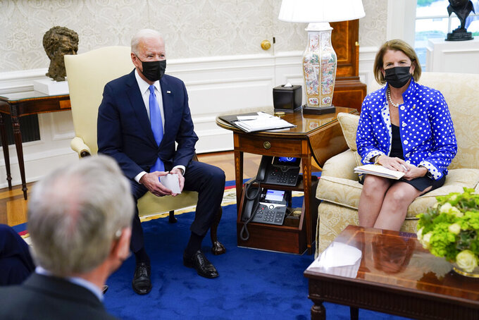 President Joe Biden speaks during a meeting in the Oval Office of the White House, Thursday, May 13, 2021, in Washington. Sen. Shelley Moore Capito, R-W.Va., right, and Sen. Mike Crapo, R-Idaho listen. (AP Photo/Evan Vucci)
