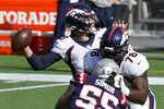 Denver Broncos quarterback Drew Lock, rear, passes as tackle Demar Dotson (78) blocks New England Patriots defensive end John Simon (55) in the first half of an NFL football game, Sunday, Oct. 18, 2020, in Foxborough, Mass. (AP Photo/Steven Senne)