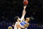 Drake forward Tremell Murphy shoots over Illinois State forward Dusan Mahorcic, left, during the first half of an NCAA college basketball game, Monday, Feb. 1, 2021, in Des Moines, Iowa. Drake won 95-60. (AP Photo/Charlie Neibergall)