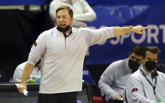 UNLV head coach T.J. Otzelberger instructs his team during the second half of an NCAA college basketball game against Utah State in the quarterfinals of the Mountain West Conference men's tournament Thursday, March 11, 2021, in Las Vegas. (AP Photo/Isaac Brekken)