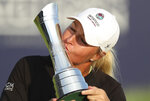 Sweden's AnnaNordqvist kisses the trophy as she poses for the media after winning the Women's British Open golf championship, in Carnoustie, Scotland, Sunday, Aug. 22, 2021. (AP Photo/Scott Heppell)
