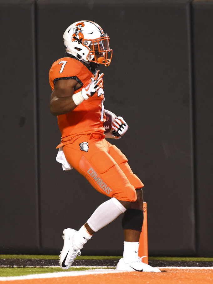 Oklahoma state running back LD Brown scores a touchdown during the fourth quarter of an NCAA college football game against Missouri State in Stillwater, Okla., Thursday, Aug. 30, 2018. Oklahoma State won 58-17. (AP Photo/Brody Schmidt)