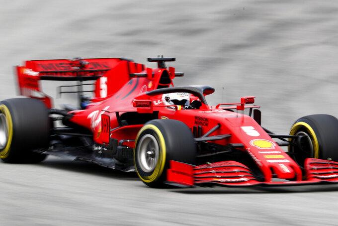 Ferrari driver Sebastian Vettel of Germany steers through a corner during the Formula One pre-season testing session at the Barcelona Catalunya racetrack in Montmelo, outside Barcelona, Spain, Thursday, Feb. 27, 2020. (AP Photo/Joan Monfort)