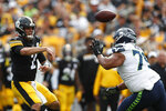 Pittsburgh Steelers quarterback Mason Rudolph (2) passes over Seattle Seahawks nose tackle Bryan Mone (79) in the second half of an NFL football game Sunday, Sept. 15, 2019, in Pittsburgh. (AP Photo/Don Wright)