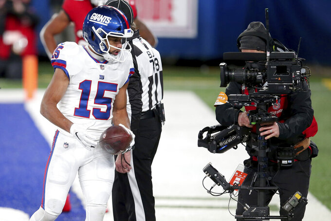 FILE - New York Giants wide receiver Golden Tate (15) talks into a television camera after scoring a touchdown against the Tampa Bay Buccaneers during an NFL football game in East Rutherford, N.J., in this Monday, Nov. 2, 2020, file photo. The New York Giants announced Thursday, March 4, 2021, that they have cut Golden Tate in a move that clears $6.1 million in salary cap space and says goodbye to a wide receiver who never panned out after signing a $37 million contract as a free agent in 2019. (AP Photo/Brad Penner, File)