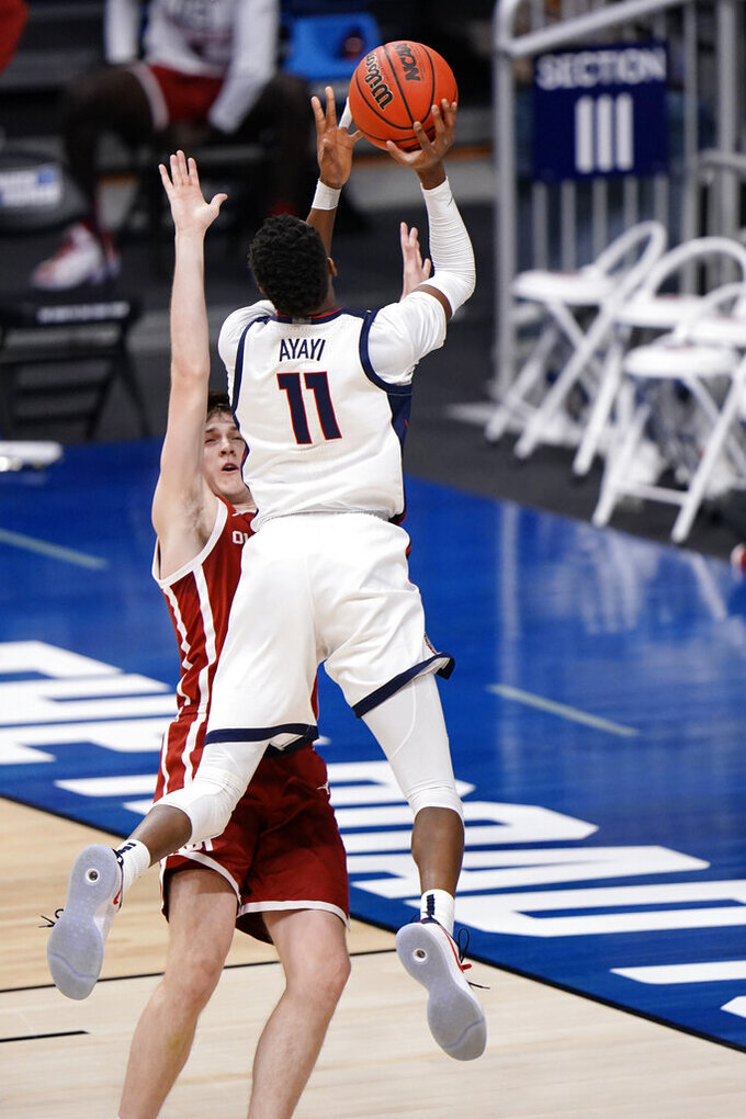 Oklahoma guard Austin Reaves, left, is fouled by Gonzaga guard Joel Ayayi (11) in the first half of a college basketball game in the second round of the NCAA tournament at Hinkle Fieldhouse in Indianapolis, Monday, March 22, 2021. (AP Photo/AJ Mast)