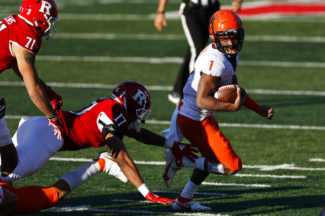 Illinois quarterback Isaiah Williams (1) rushes away from Rutgers linebacker Deion Jennings (17) during the second half of an NCAA college football game, Saturday, Nov. 14, 2020, in Piscataway, N.J. Illinois won 23 - 20. (AP Photo/Adam Hunger)