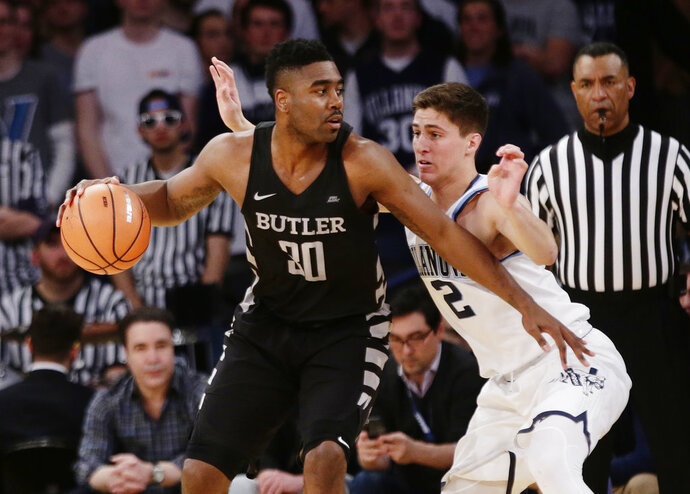 FILE - In this March 9, 2018, file photo, Butler's Kelan Martin (30) drives against Villanova's Collin Gillespie (2) during the first half of an NCAA college basketball game in the Big East men's tournament semifinals, in New York. Kelan Martin always has been a special scorer. This season, he learned to thrive in a new role — team leader.(AP Photo/Frank Franklin II, File)