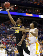 Iowa's Tyler Cook (25) drives to the basket against Tennessee's Kyle Alexander (11) in the second half during a second round men's college basketball game in the NCAA Tournament in Columbus, Ohio, Sunday, March 24, 2019. Tennessee won 83-77 in overtime. (AP Photo/Tony Dejak)