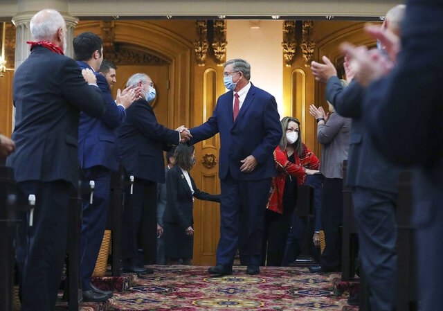 FILE - In this file photo from July 30, 2020, Ohio state Rep. Bob Cupp, center, is congratulated after being elected Speaker of the House at the Ohio Statehouse in Columbus, Ohio. Cupp begins to lead the Ohio House as members of his party tout him as the